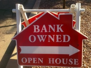Sign reading bank owned open house